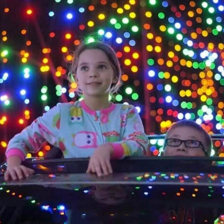 Kids in Drive Through Christmas Light Tunnel