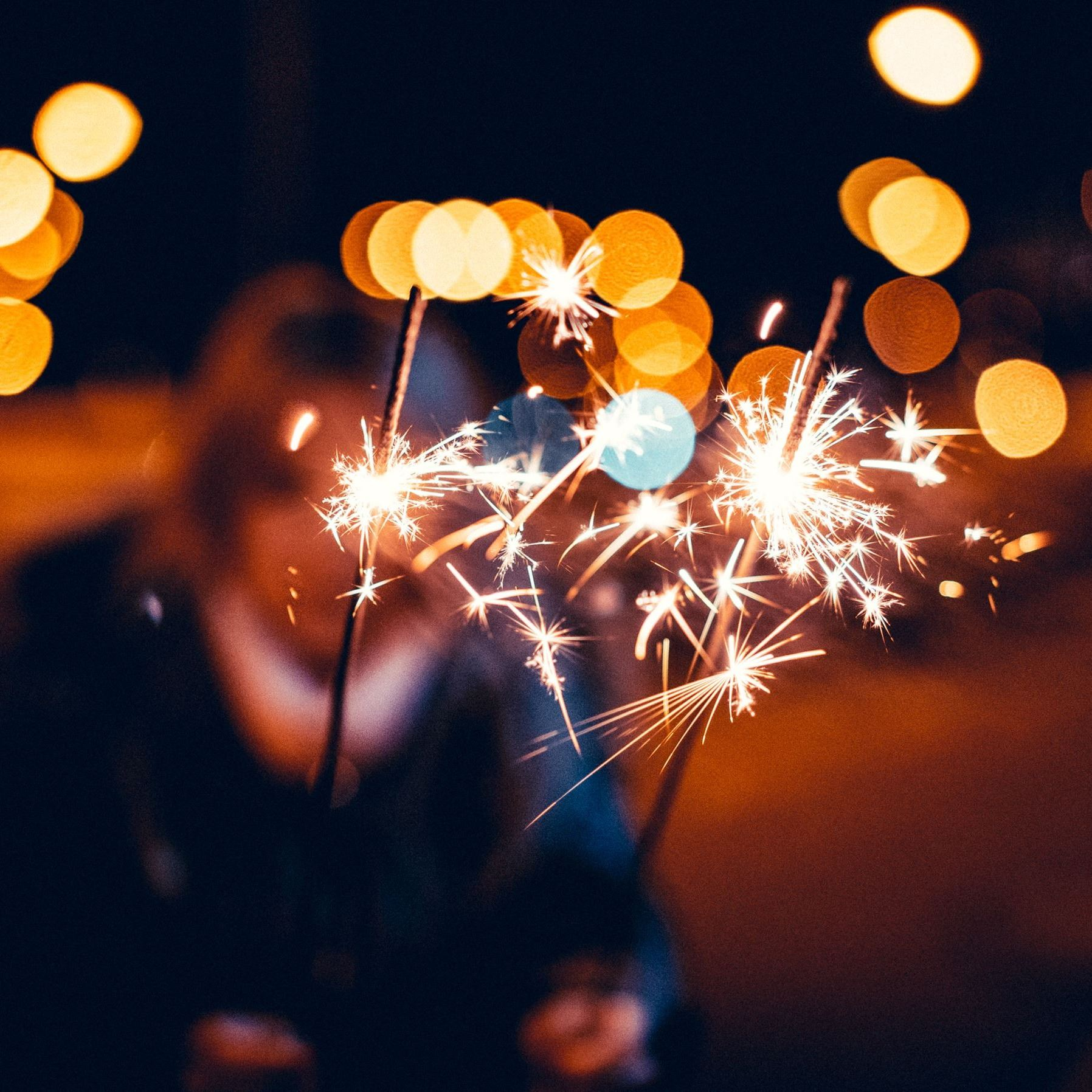 woman-holding-sparklers-in-hands-picjumbo-com
