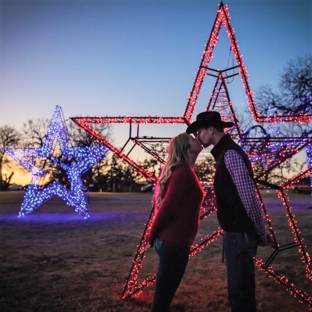 Stealing a Kiss at Old West Christmas Light Fest
