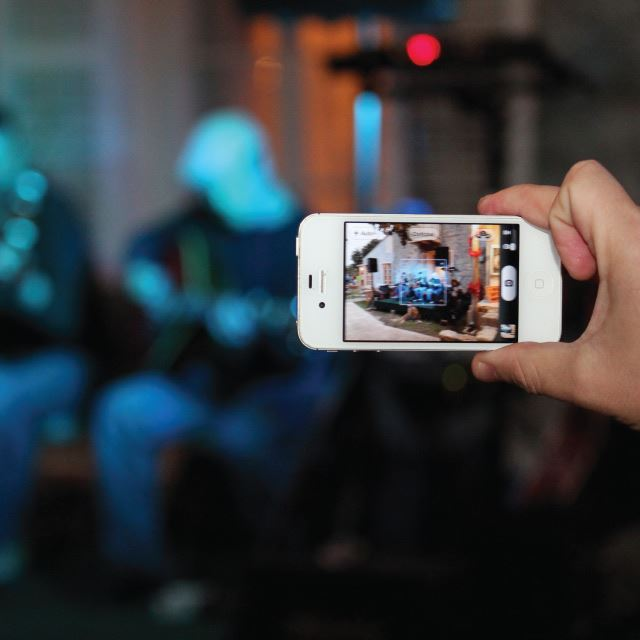 Phone taking video at an event