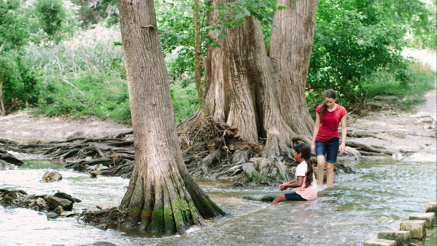People playing in the Cibolo Creek- Photo by Allison Russell